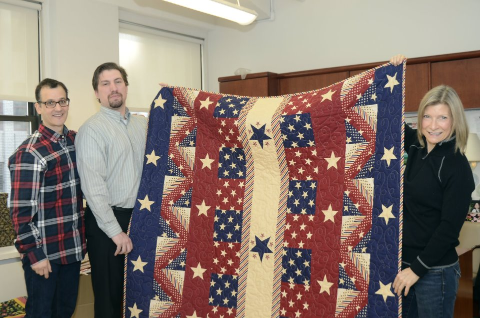 Quilts of Valor recipient Roger Leathers with David Weinstein and Gail Kessler